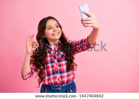 Portrait of cute nice pretty lady people kid excellent weekend rest make photo blog share blogger live excited cheerful content wear checked shirt stylish long hairdo isolated pink background