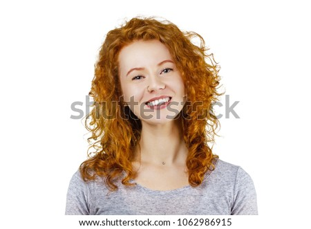 Stock Photo Portrait of cute redhead girl with curly hair in gray t-shirt, smiling looking at camera. Isolated on white background