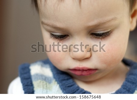 Portrait of cute sad crying toddler child or baby, girl or boy.