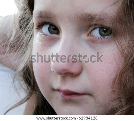 Portrait of cute small girl crying