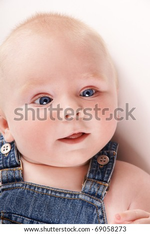 Portrait of cute smiling baby-boy with blue eyes, studio shot - stock