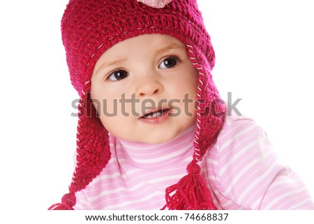 Portrait of cute smiling baby girl in pink hat isolated on white background