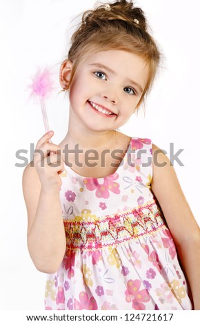 Portrait of cute smiling little girl in princess dress isolated