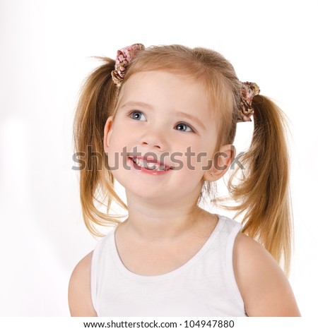 Portrait of cute smiling little girl isolated
