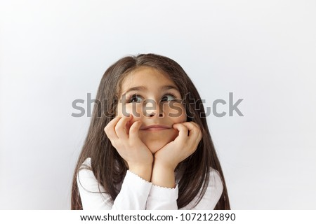 Portrait of cute thoughtful child girl. Dreaming people. Space for text.