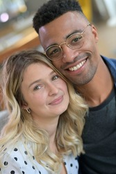 Portrait of cute 30-year old mixed-raced couple