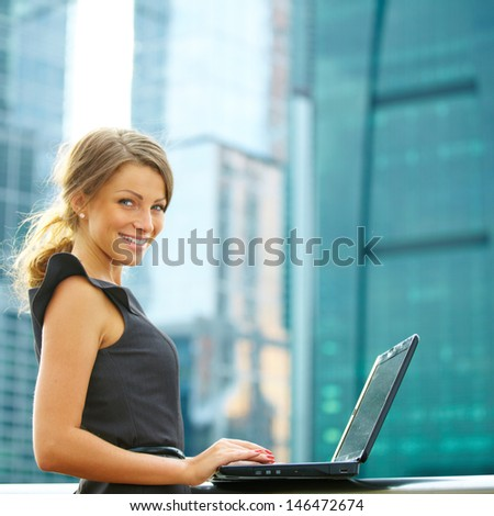 Business woman outdoor over building background with globe