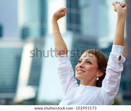 Successful business woman over building background