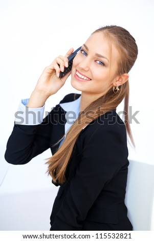 Portrait of cute young business woman talking on the cell phone