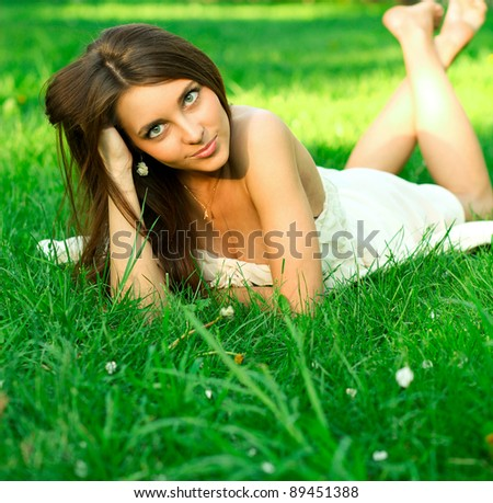 portrait of cute young teenage girl relaxing in spring park