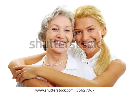 Portrait of daughter embracing her mother and looking at camera