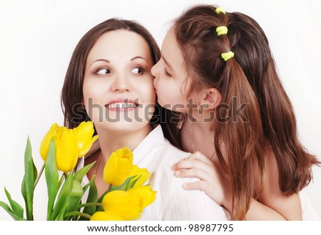 Portrait of Daughter kissing her mother