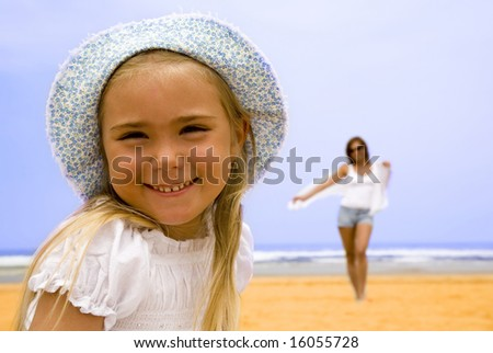 Portrait of daughter with mother on the beach