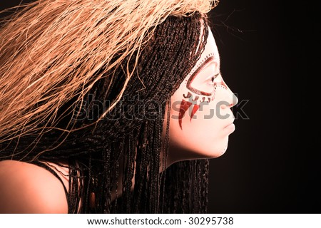 Stock Photo Portrait of decorated ethnic young woman