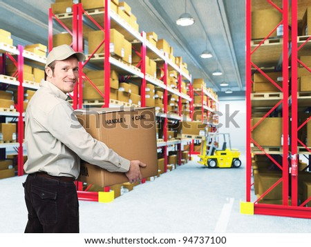 portrait of delivery man in classic warehouse