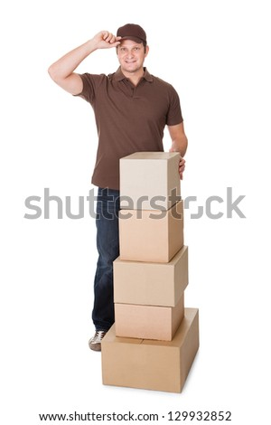 Portrait of delivery man with stack of boxes. Isolated on white background