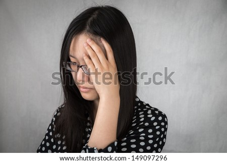 Portrait of depressed girl holding her head