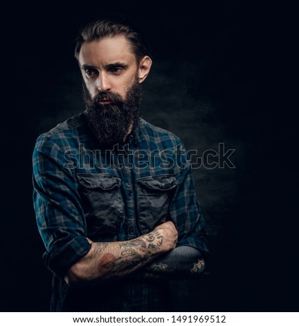Portrait of depressed middle aged male in dark checkered shirt on the dark background. #1491969512