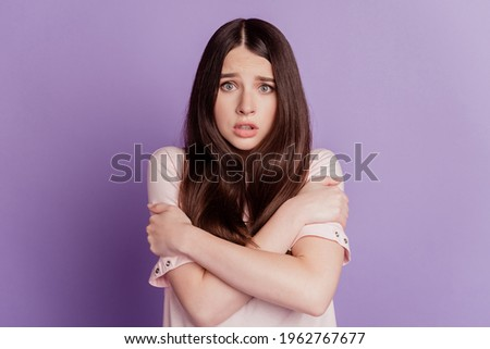 Portrait of deserate unhappy woman hands embrace shoulders freeze isolated on purple background Zdjęcia stock ©