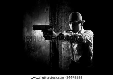 portrait of detective with pistol