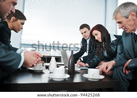 Portrait of director  having coffee in office meeting