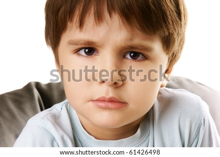 Portrait of displeased little boy isolated on white background