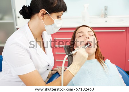 portrait of doctor and patient at dentist's office