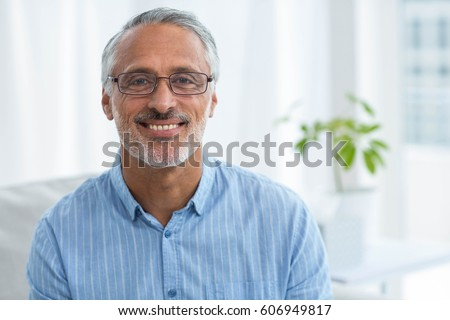 Portrait of doctor smiling at home #606949817