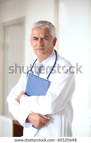 Portrait of doctor standing in hall