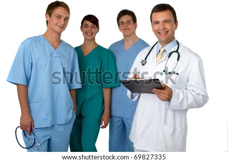 Portrait of doctor with three practitioners in the background