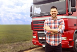 Portrait of driver at modern truck outdoors. Space for text