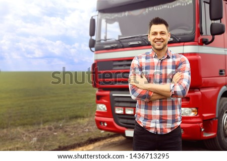 Portrait of driver at modern truck outdoors. Space for text #1436713295
