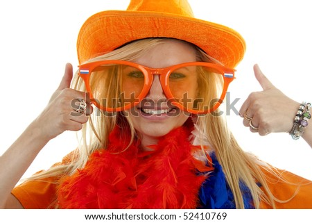 Portrait of Dutch soccer fan in orange outfit with big funny glasses and thumbs up posing over white background