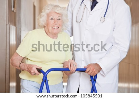 Portrait of elderly woman and doctor with zimmerframe.