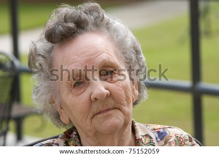 Portrait of elderly woman outside during day