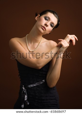 Portrait of elegance young woman wearing a string of pearls