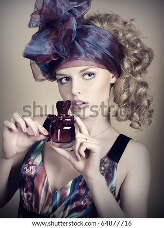 Portrait of elegant and sexy woman with perfume. Art and beauty