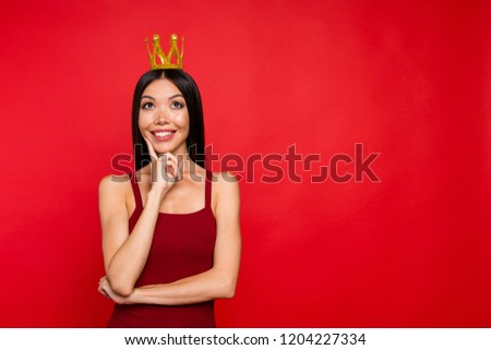 Portrait of elegant graceful glamour attractive pretty well-groomed rich royal princess lady look up she stand isolated on red her shine background touch cheek by finger