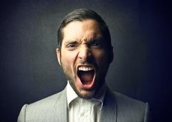 portrait of elegant man screaming