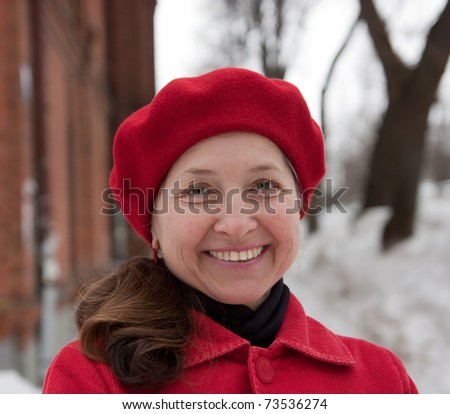 Portrait of elegant senior lady in overcoat outdoor during winter day