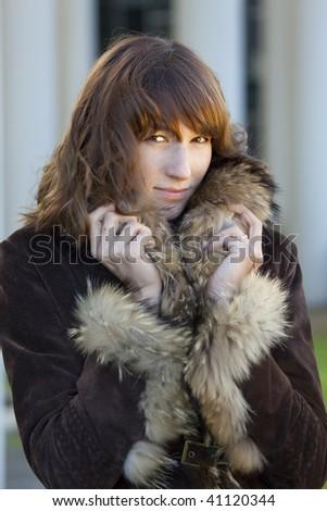 portrait of elegant woman in fur coat outdoor