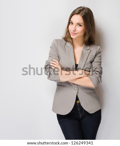 Portrait of elegantly dressed young gorgeous brunette woman.