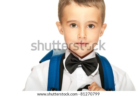 Portrait of elementary school boy with backpack isolated on white - stock photo