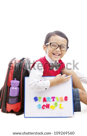 Portrait of elementary school student with bag and drawing board ready back to school