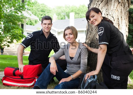 Portrait of emergency team with healthy recovering patient