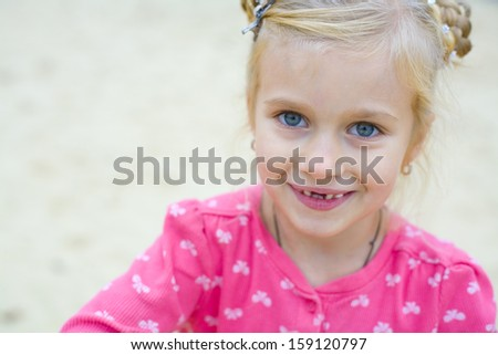 portrait of emotional beautiful five-year-old girl outdoors