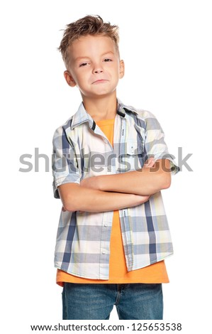 Portrait of emotional boy with hands folded isolated on white background