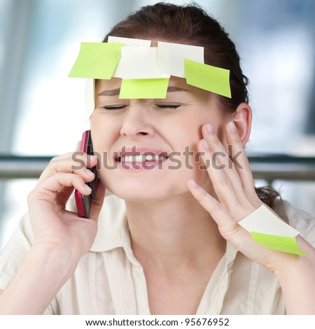 Portrait of emotional business woman with note papers