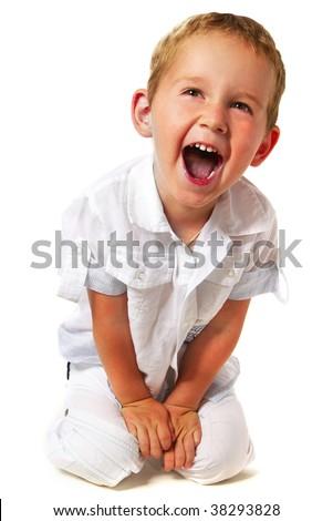 portrait of emotional kid sitting - stock photo