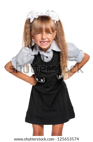 Portrait of emotional little girl in school uniform, isolated on white background